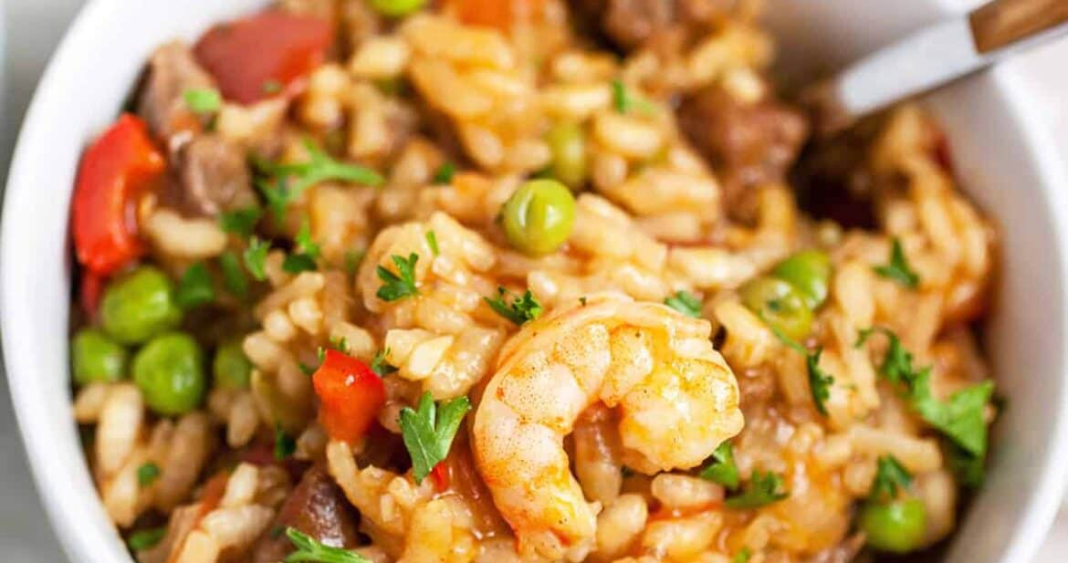 Close up of shrimp and beef easy paella recipe in a white bowl