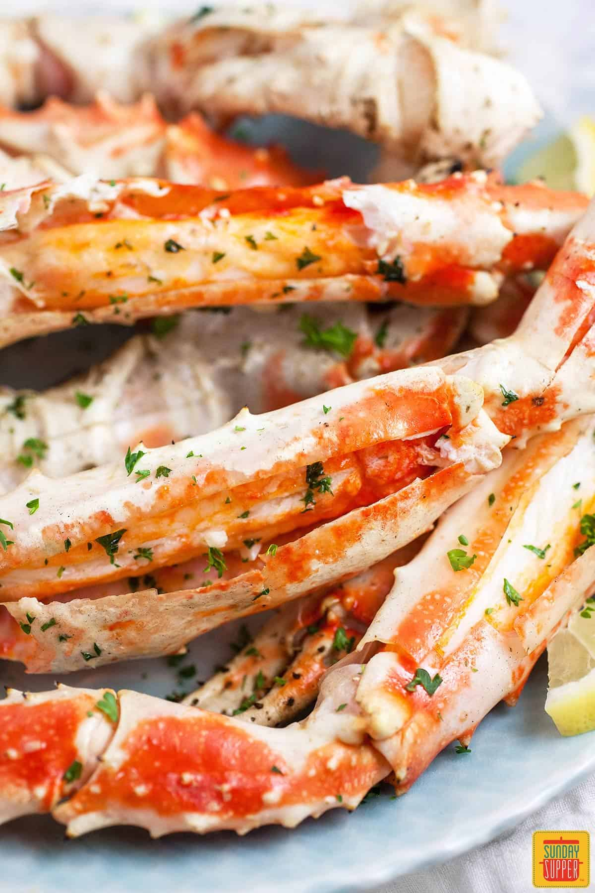 Close up of grilled crab legs on a platter