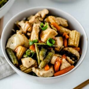 Close up of easy chicken stir fry in a white bowl