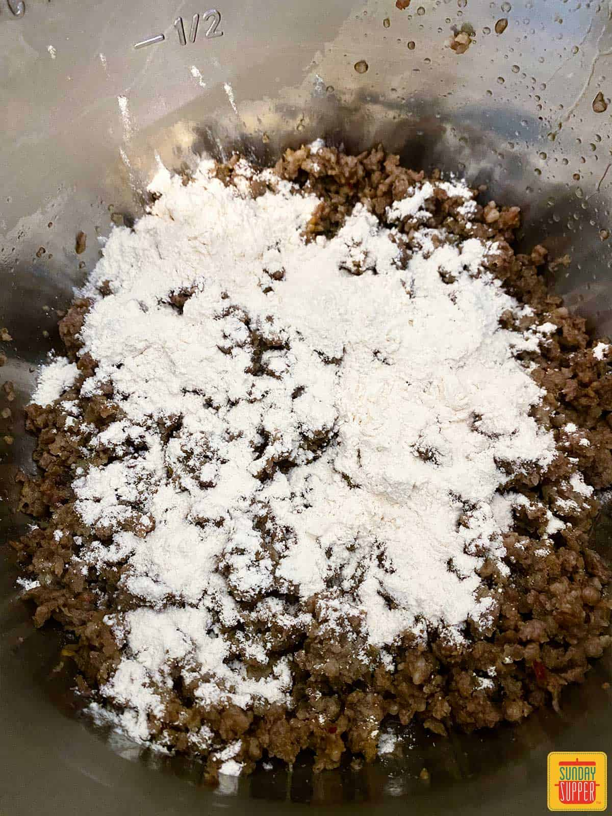Flour sprinkled over sausage in the instant pot