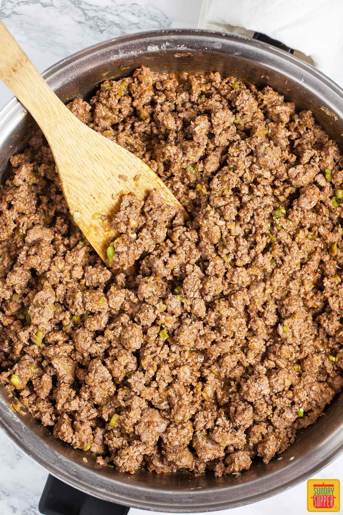 Cooking ground beef for Mexican lasagna