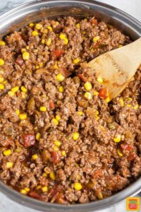 Mixing the ground beef lasagna filling