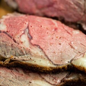 Two slices of boneless prime rib roast up close