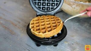 Lifting the banana bread waffle out of the mini waffle maker
