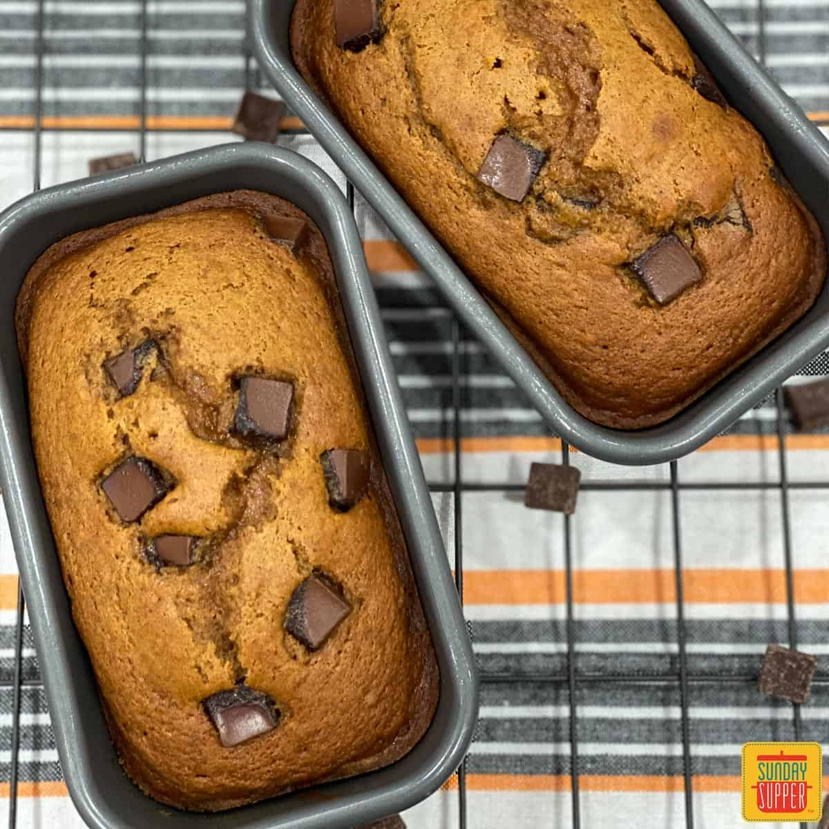 Two loaf pans of chocolate chip pumpkin bread