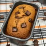 A close up loaf pan with chocolate chip pumpkin bread