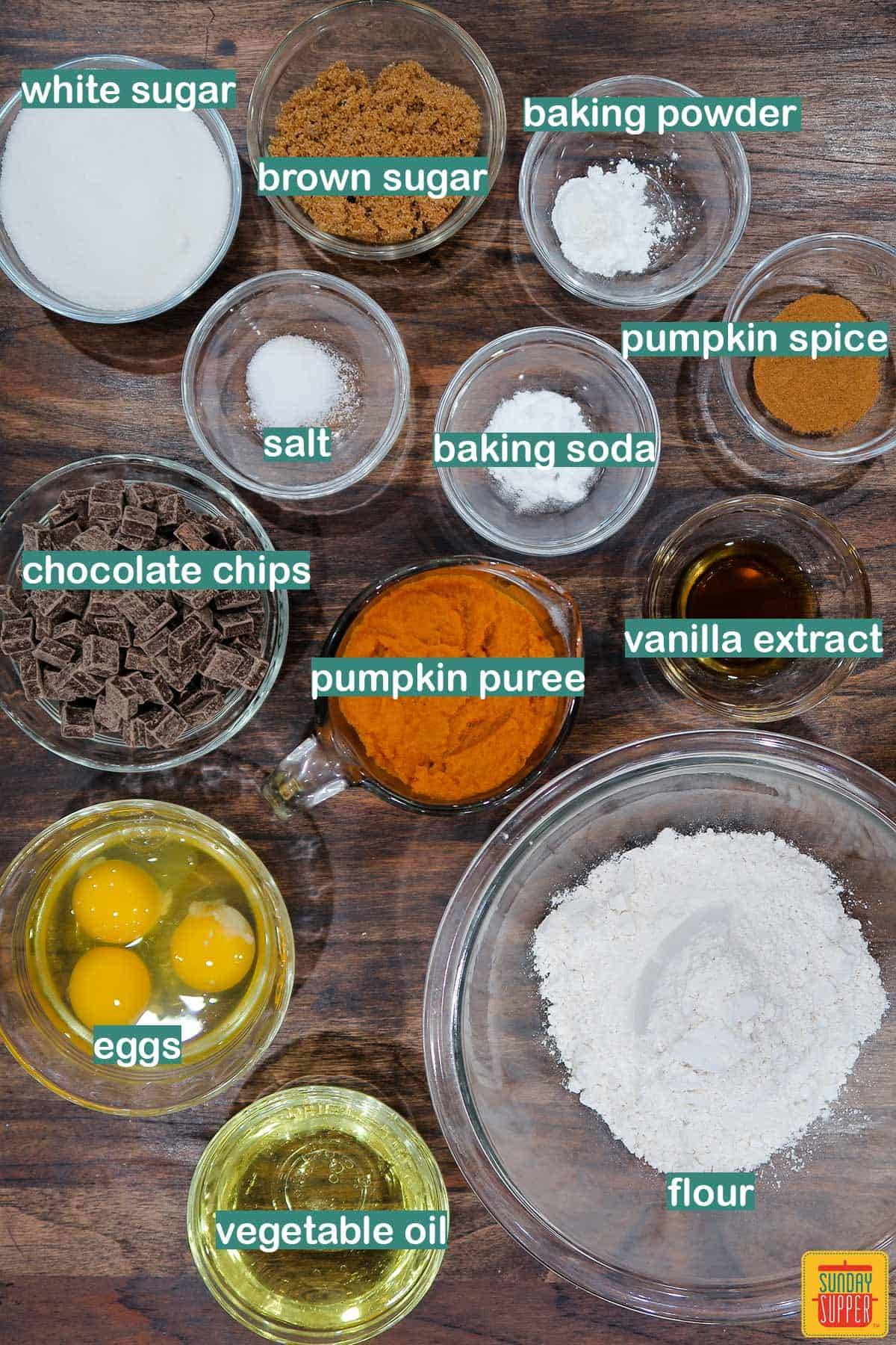 Ingredients to make Instant Pot Pumpkin Chocolate Chip Bread laid out on a table with labels