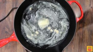 Melting butter and cooking garlic in a skillet