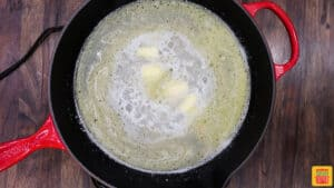 Lemon butter sauce cooking in a skillet