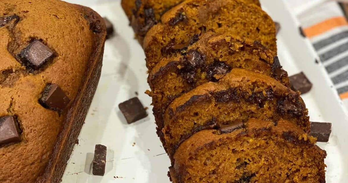 Slices of instant pot pumpkin chocolate chip bread next to a full loaf