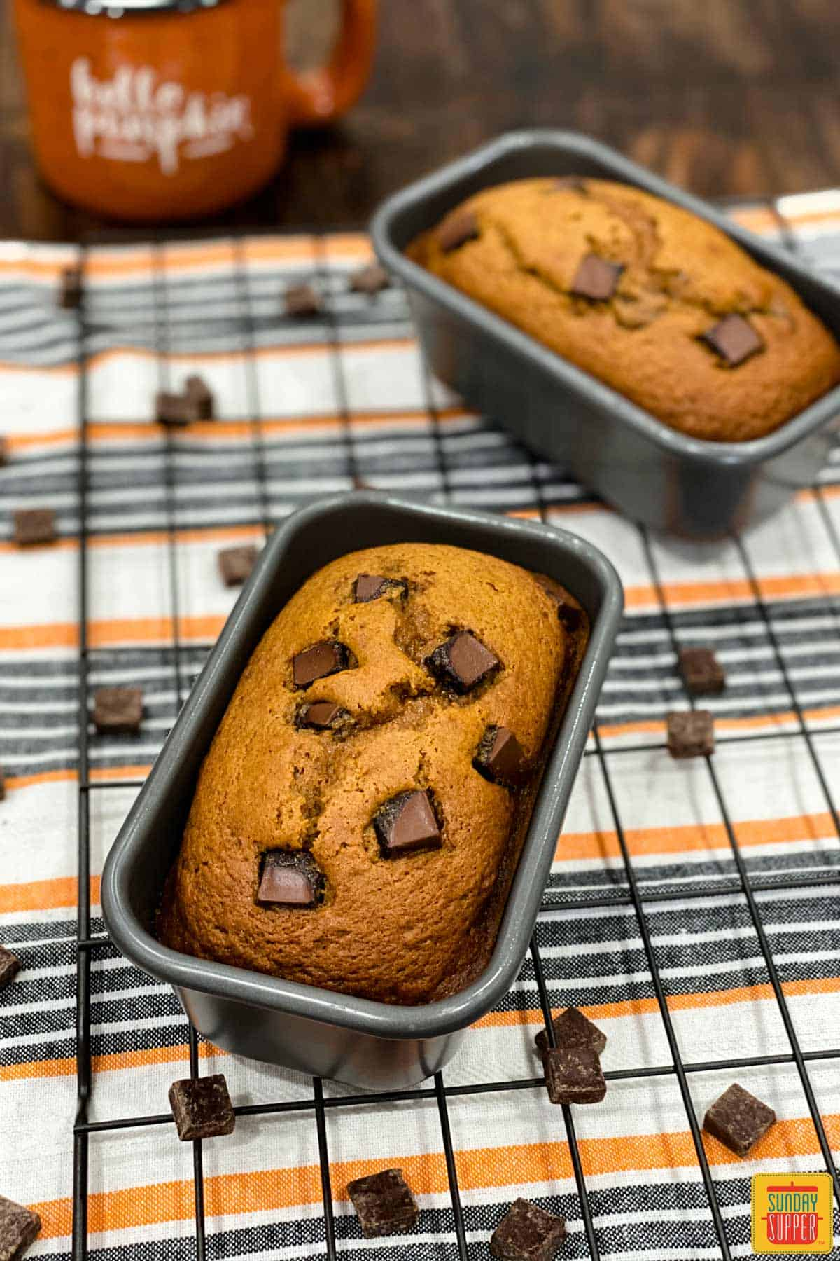 Two mini loaf pans with instant pot pumpkin bread topped with chocolate chips
