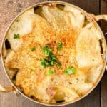 Overhead view of Swedish potato casserole Janssons Frestelse in a baking dish with handles