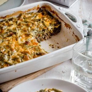 White casserole dish with keto cheeseburger casserole, missing a serving