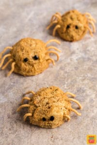 Three mashed potato balls formed to look like cute spiders for Halloween