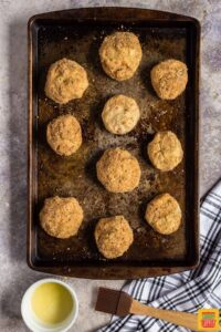 Stuffed potato balls on a baking sheet