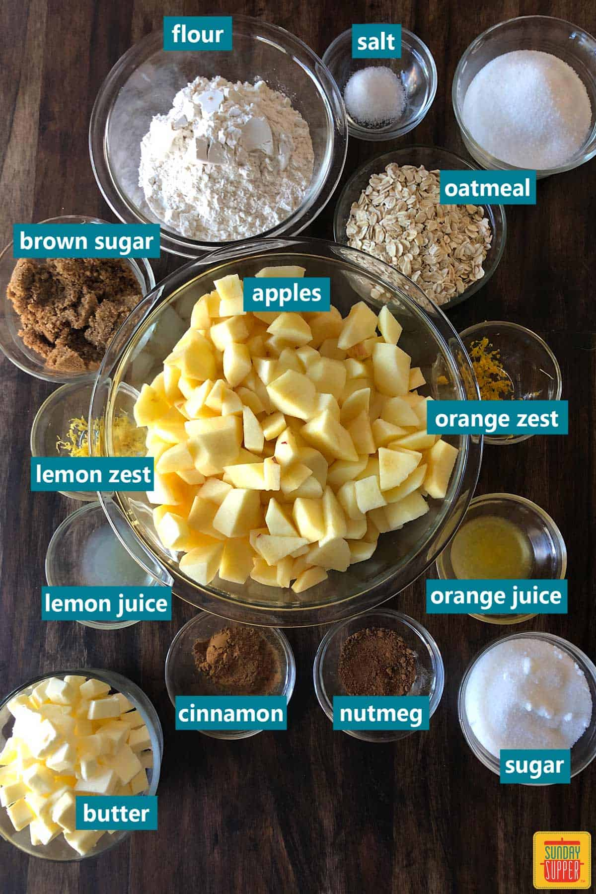 apple crisp ingredients with labels on a brown table
