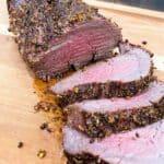 Grilled tenderloin recipe sliced on a cutting board