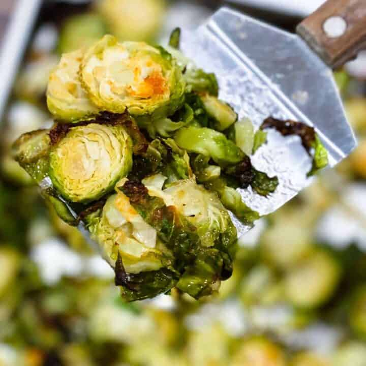 Roasted brussels sprouts on a metal spatula
