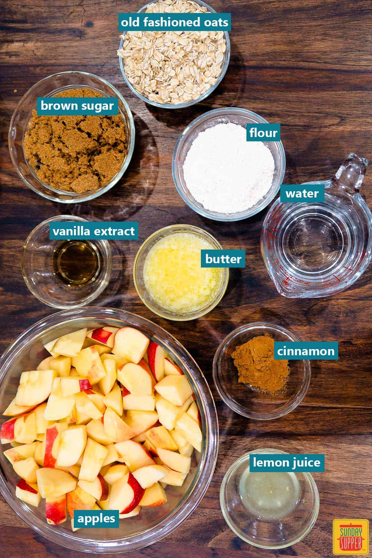 Instant pot apple crisp ingredients with labels on a table