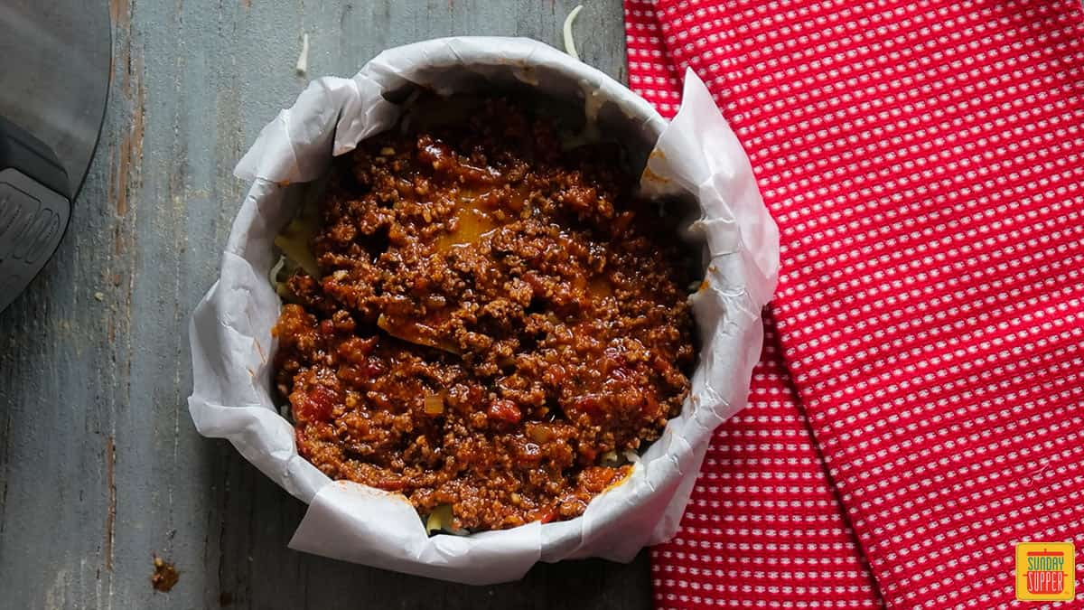 the final layer of meat sauce