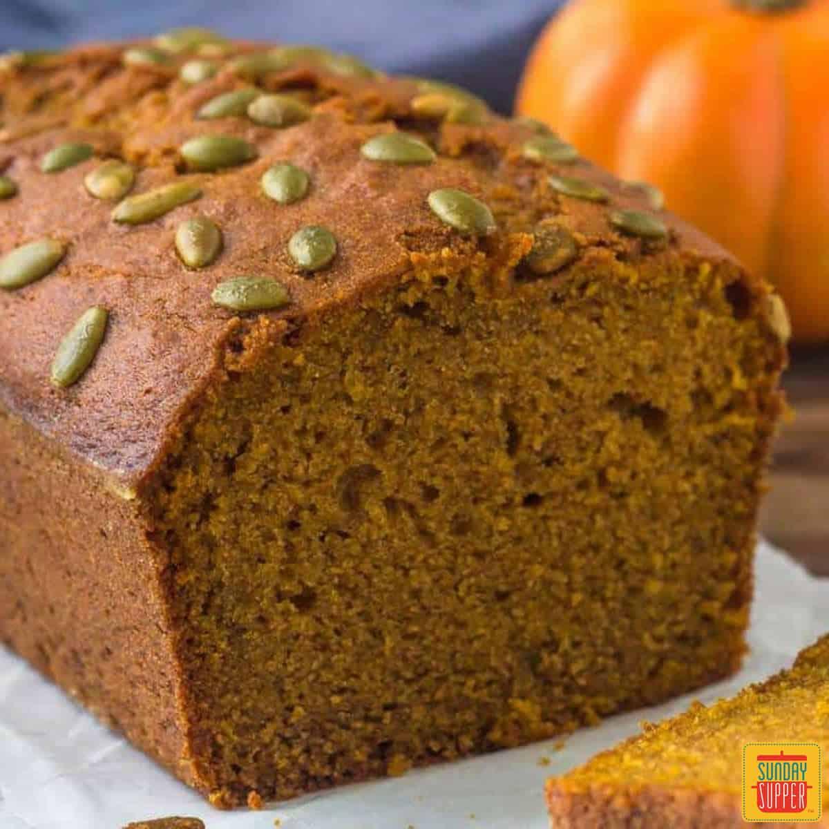 Starbucks pumpkin bread loaf with pumpkin seeds on top