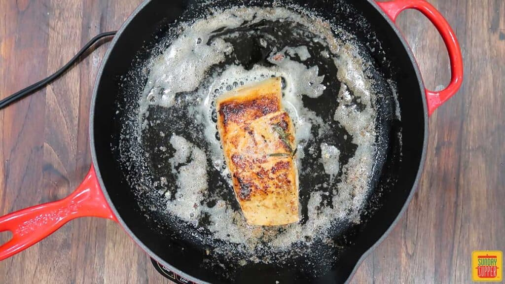 Cooking salmon skin-side down in a skillet