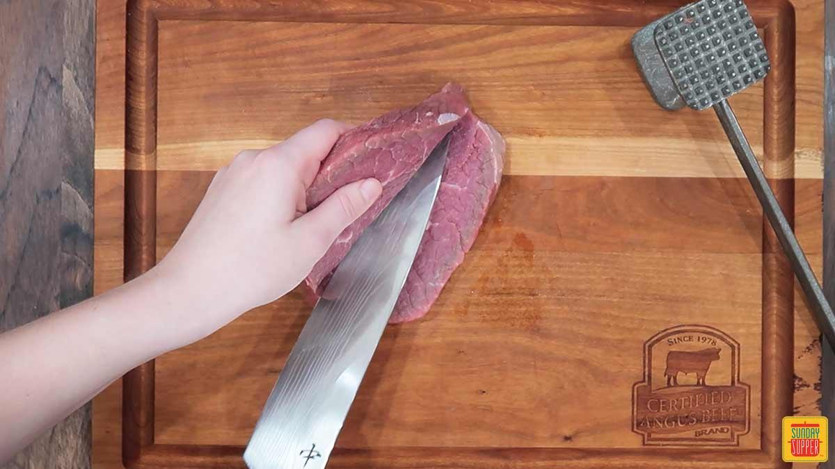 Cutting a steak in half