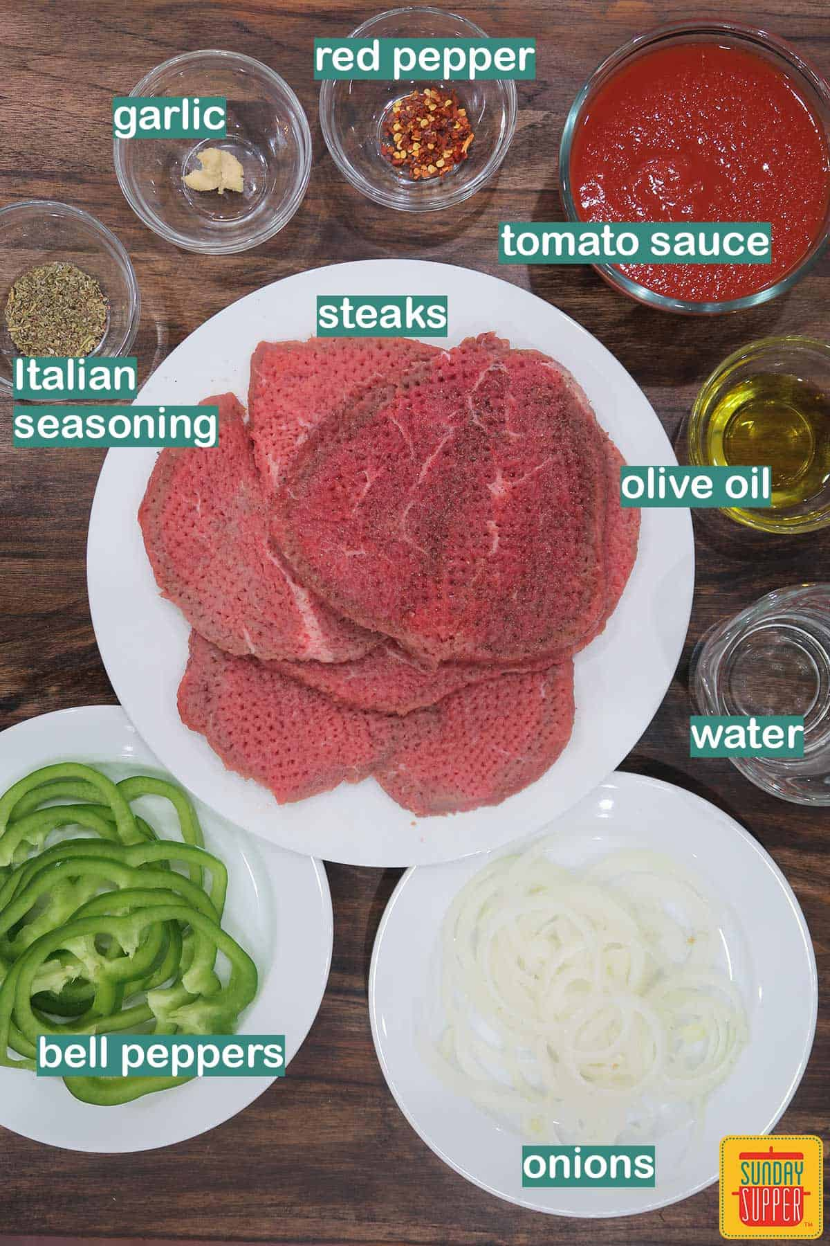 Ingredients for steak pizzaiola labeled on the table