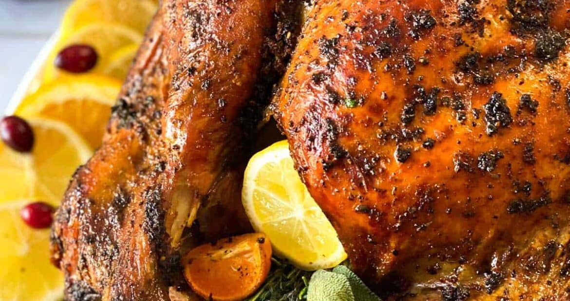 Grilled turkey recipe up close stuffed with citrus and herbs