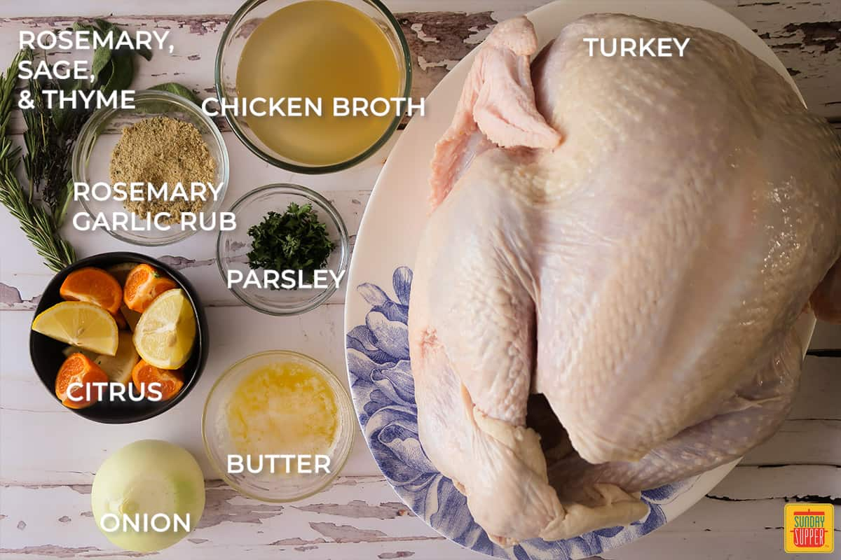 ingredients for grilled turkey labeled on a white table
