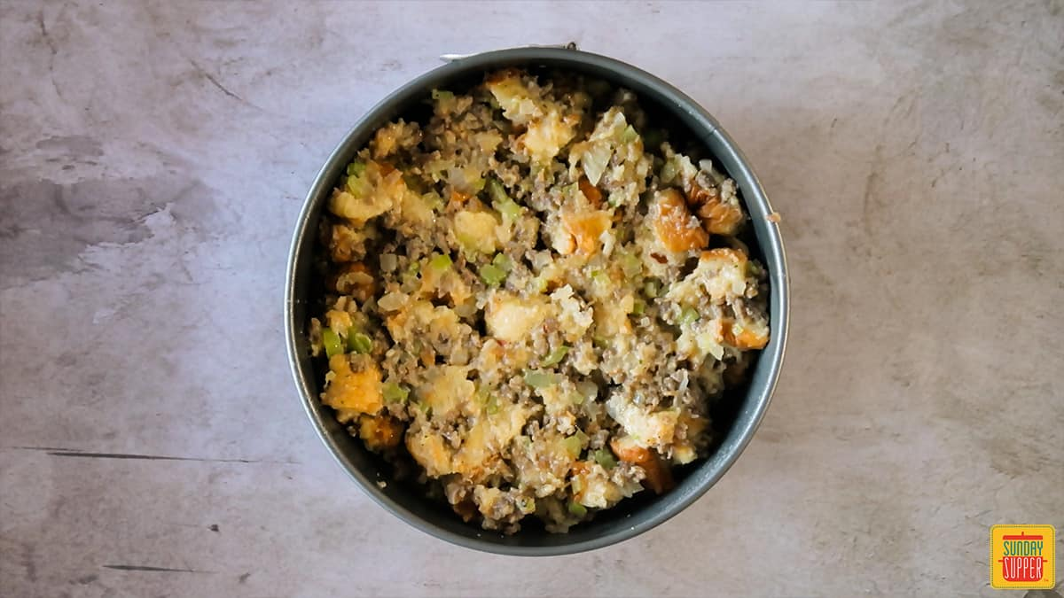 Instant pot sausage sage stuffing in a springform pan ready to cook