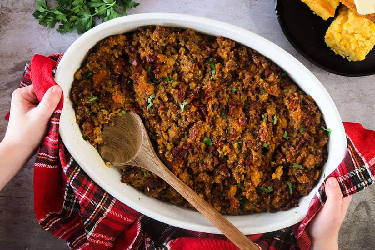 Portuguese Stuffing in a white dish with a wooden spoon