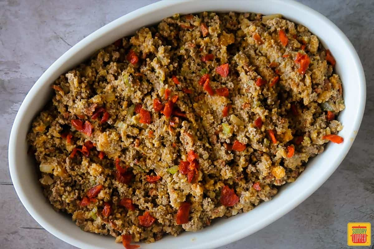 cornbread stuffing topped with chorizo and ready to be baked