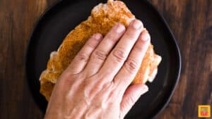 Patting rub onto turkey breast