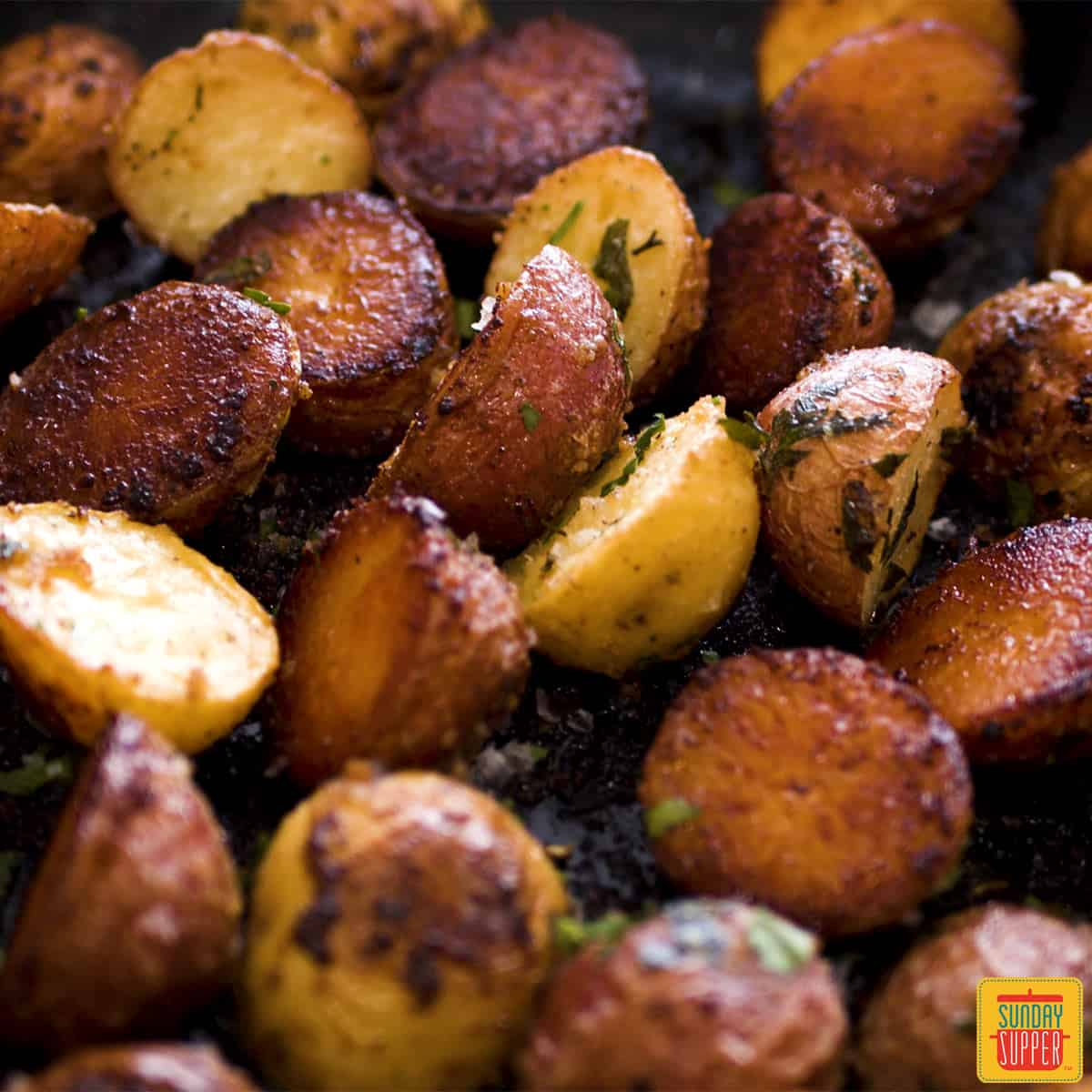 Close up of roasted potatoes in a skillet