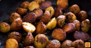 Small roasted creamer potatoes close up in a skillet after cooking