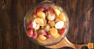 Seasoned small potatoes in a glass bowl
