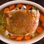 Close up of a turkey in a dutch oven with turkey rub on top