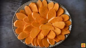 sweet potatoes sliced on a platter in a circle pattern