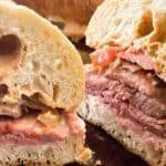Two halves of a hot roast beef sandwich up close