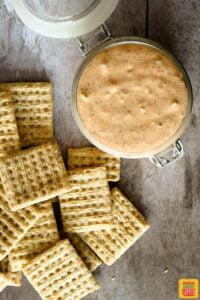 Remoulade sauce in a glass jar with a lid next to crackers