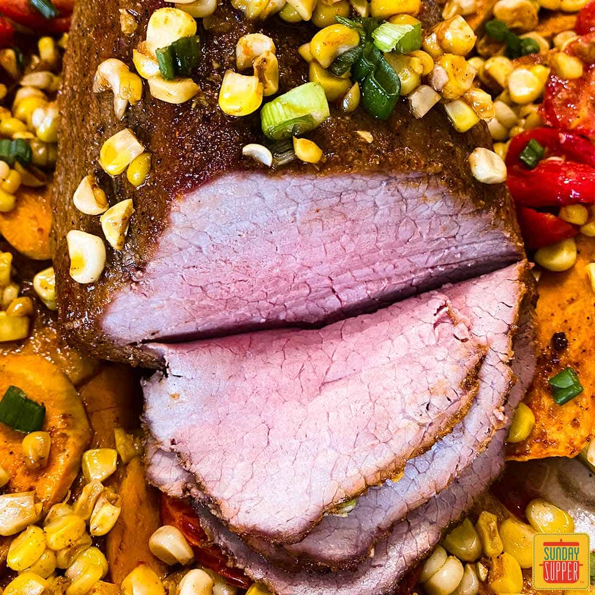 close up of eye of round roast seasoned with sweet and salty roast beef rub