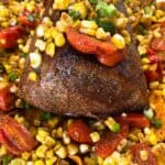 seasoned eye of round roast with sweet and salty roast beef rub on sweet potatoes, corn, and tomatoes