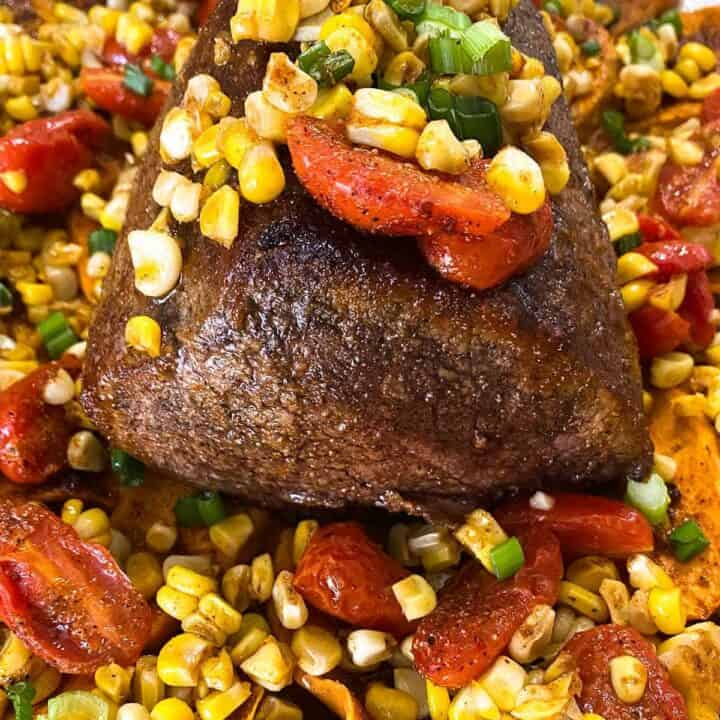 seasoned eye of round roast with sweet and salty roast beef rub on sweet potatoes, corn, and tomatoes