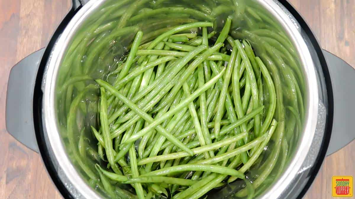 Uncooked green beans in pressure cookekr