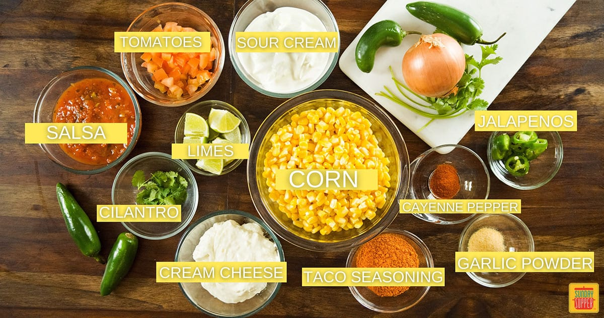 Ingredients to make mexican dip labeled on a table