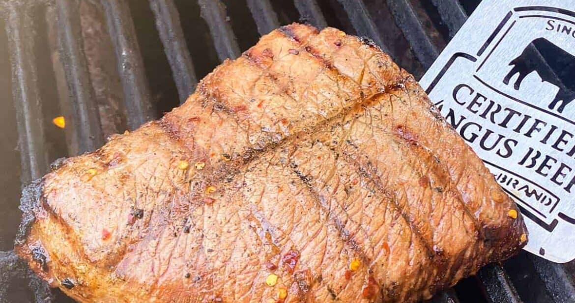 London broil cooking on the grill