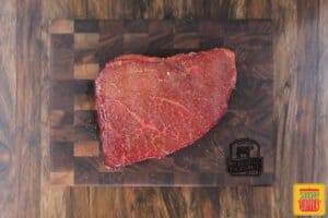 Cut of london broil on a cutting board