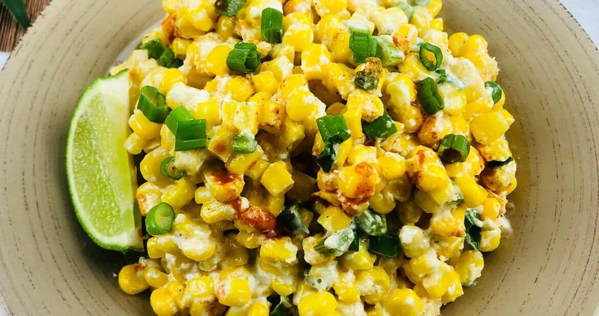 Plate of Mexican street corn casserole with lime