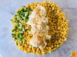 Mexican street corn ingredients in a glass bowl